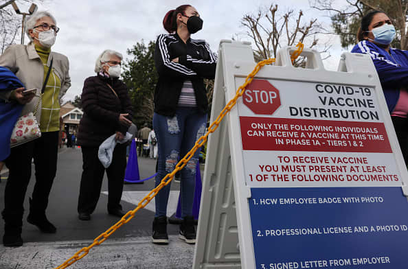 Biden administration to begin shipping Covid vaccine doses to community